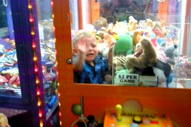 868697-toddler-trapped-in-game-machine